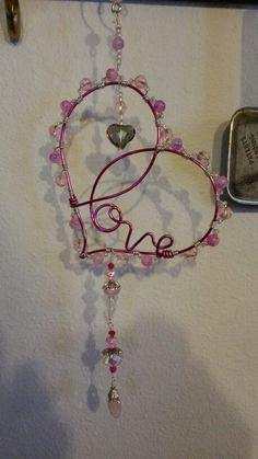 Wire wrapped beaded sun catcher,  heart love.