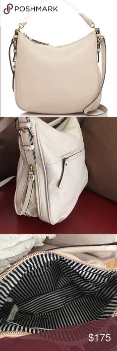 Kate spade New York cobble hill Ella white bag this is a nearly new Kate spade New York cobble hill Ella in off-white/cream (not sure the official color name). can be worn cross-body or carried with the top handle. has extending zipper for extra room and a black and white striped lining. inside and back have pockets/zippers. super cute! comes with duster bag. kate spade Bags Crossbody Bags