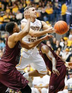 Wichita State's John Robert Simon splits the Missouri State defense as he scores in the second half at Koch Arena Saturday. (Feb. 7, 2015)
