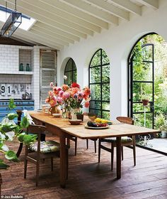 Every home reflects its owner's personality Before John and Carol bought the property, it was being used as a café, with serviced apartments above and a mess of shabby outbuildings at the back. These were demolished to make way for a single large room, wi Interior Barn Doors, Home Interior, Interior And Exterior, Interior Decorating, Modern Interior, Arched Doors, Arched Windows, Oak Doors, Interior Design Elements
