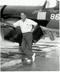 Postwar photo of Pappy Boyington with a restored Corsair.