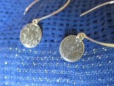 Stunning silver druzys set in sterling silver and hanging from sterling silver kidney ear wires.  These are the piece you will never forget!  a must have,  Checkout these and all of the druzy ideas on our site will make you fall in love with our little beauties.