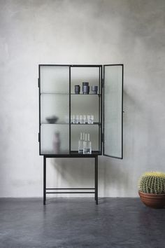 The freestanding Haze Vitrine cabinet from Ferm Living is cool as well as elegant. The vitrine is crafted from sleek powder coated metal and textural armoured glass. Decor, Furniture, Interior, Interior Furniture, Glass Cabinet, Home Decor, House Interior, Furnishings, Furniture Design