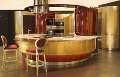 Extremely luxurious GOLD & BURGUNDY kitchen; interior design;GLAM; posh;Marazzi Design unveiled their newest kitchen - the Colosseo Oro. This 24-carat gold leaf kitchen has crocodile-skin finishings and glittered Venetian glass surfaces. Only 10 will be made and they start at £300,000. If the price doesn't put you off, please be aware that you do need a kitchen that is a whopping 12 square metres. I think i may just get this rather fantastic tap for £6,000 instead:........