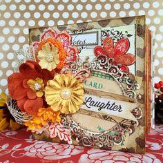 Hidden hinge scrapbooking minialbum in autum colours with prima flowers.