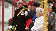 Prince Harry, Catherine, the Duchess of Cambridge, Prince William and Queen Elizabeth II watch the proceedings on board the royal barge during the Diamond Jubilee Pageant on the River Thames in London on Sunday, June 3, 2012. (AP Photo/John Stillwell)