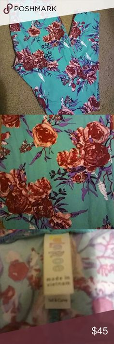 Lularoe TC mint floral leggings Beautiful mint - teal color with dark pink roses and a touch purple and white. Only worn once. Really want to keep but TC is too big for me since losing weight :( LuLaRoe Pants Leggings