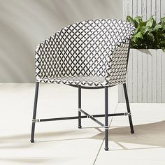 brava dining-lounge grey wicker chair $299. Black and White theme. would look nice surrounded by white planters like in this photo