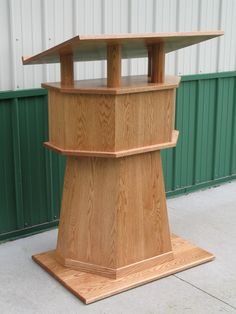Lecturn: a stand that you can sit a book or papers on while you are presenting and can read from