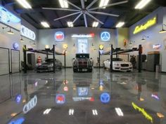 Custom heated and cooled garage space is a car collector's dream man cave, accommodating up to 14 cars!