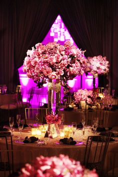25 Stunning Wedding Centerpieces - Part 2 via Belle The Magazine, like the size and shape and purple lighting