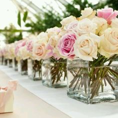 Glass cube with pink and ivory rose on white runner on imperial table