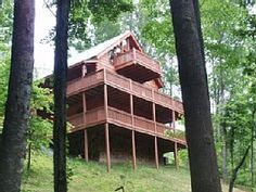 """""""Huckleberry Hideaway"""" is a spacious 3BR/3BA cabin has everything you want and more all within a beautiful mountain setting. As you enter into the cabin you will find the fully equipped kitchen with dishwasher ..."""