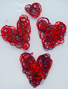 BEAUTIFUL Yarn Hearts -- this is really cute and would be fun to do in other shapes to fit other occasions and holidays.