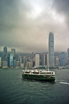 Hong Kong Star Ferry on a Cloudy Day Hong Kong Architecture, Macau Travel, Star Ferry, British Hong Kong, Victoria Harbour, Modern City, Cloudy Day, Travel Memories, Thing 1