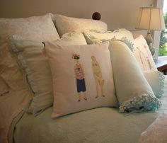 Love this bedding and the fun pillows - cute!