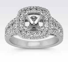 Advancing sizes of round diamonds lead to the top of a gorgeous double halo engagement ring to hold the center gemstone of your choice at approximately 1.00 carat. Ninety-two round diamonds, at approximately .93 carat total weight are crafted in quality 14 karat white gold to create a wonderfully astounding ring to present to the love of your life.