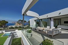 chic-house-with-curving-two-story-patio-9-upper-deck-edge.jpg
