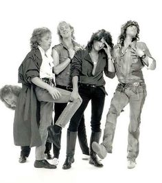 Aerosmith. Haha, Joe Perry looks so uncomfortable.