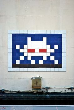 'Invader' mosaic street art - these tiled space invaders can be found all over London, and in cities around the world.