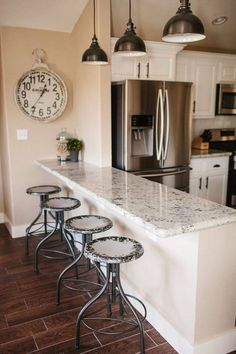 Like the lights and the countertop might work with the cabinets. Modern kitchen lighting