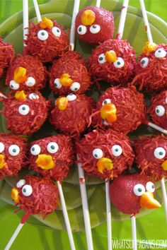 A DIY Elmo Sesame Street Themed Twins 2nd Birthday Party for girls. Making Elmo head cake pops! These are cute (and funny).