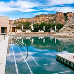 The Amangiri Hotel pool in Utah resembles a serene lake and is literally carved into the landscape, flowing around millions-year-old rock.  It's within striking distance of Zion National Park.
