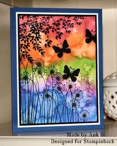 By Ank. Apply drops of reinker to wet watercolor paper. Then flick a wet toothbrush all over the piece until you like the look. Dry completely. Use black StazOn for the silhouette stamps: tree branch, flowers, butterflies. http://stampinbackart.blogspot.nl/2013/08/water-color.html