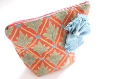 make up bag // orange, green leaves blue flowers and blue flower embellishment with pearl center