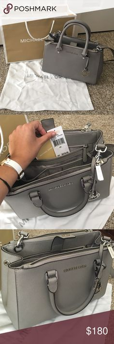 Grey Michael Kors Crossbody/shoulder/handbag Beautiful, only used once MK Sutton in Grey Leather. Still have the original tag inside the bag. Guaranteed authentic, comes with dustbag and shopping bag. In perfect, like new condition. I'm moving across the country and need to downsize, taking offers  it's a beautiful and classy bag that can hold a lot of stuff! Can be worn as a crossbody, a shoulder bag or just on your arm. Really versatile. Dimensions: 11 L x 8 H x 4.5 W. Ask any and all…