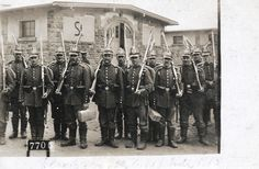 Unidentified Landwehr unit at Elsenborn, 1915.  The men are wearing pre-war Dunkelblau uniforms and M1860 Tschakoes with the Landwehr cross. They are armed with Gew88 and have ersatz bayonets on them.