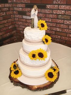 Rustic Buttercream Wedding cake with Sunflowers, by Amy Hart