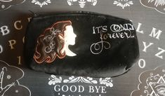 A black velvet purse, embroidered and appliqued with 'It's Only Forever'