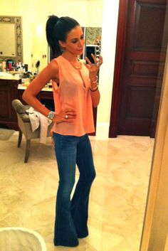 Pretty sure its her i want to look like more so than the outfit...or maybe its the high pony:)  Wide Legged Jeans and High Pony