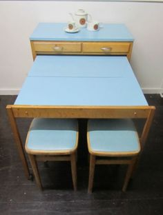 Space saving 50s table and chairs. I guess this explains how they fit a table in my tiny little kitchen! Even though its small, I love my vintage home! Love this little table too!