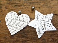x4 Embossed metal heart ornaments for use as Christmas tree decorations, or hanging all year around. They are hand cut from silver embossing shim and my boho tribal patterns are all embossed freehand, using hand tools. A thin, soft wire loop is attached at the top and a beautiful Tibetan style silver bead adorns each heart.  As they are hand made, there will be minor differences with each hearts geometric design.   approx size: heart 8 x8cm (3) length with wire 16cm (6)   * It's difficult to…