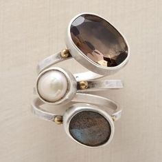 VICE VERSA RING TRIO--A cultured pearl joins irregular gems: a labradorite with facets facing out, smoky quartz with facets facing in. A handcrafted exclusive in sterling silver with brass granulations. Set of 3. Whole sizes 5 to 9.