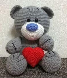 Knitted amigurumi crochet teddy bear