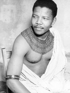 Africa | A young Nelson Mandela wearing an authentic beaded necklace of the Thembu clan (Xhosa).  He posed for this portrait while on the run, when he was known as the Black Pimpernel. Photo taken in the 1960's. The photograph could not be shown and was illegal to posses ~ it was banned ~ up until the ANC was un-banned and Mandela released from Prison in the early 1990's.