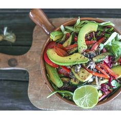 MEXI salad for lunch marinated mushrooms, capsicum and zucchini on a crispy salad of lettuce, spinach, avo and beetroot. Drizzled with lime