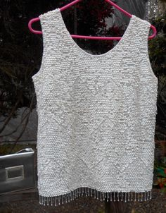 A personal favorite from my Etsy shop https://www.etsy.com/listing/206634570/sparkly-sequin-beaded-vintage-sleeveless