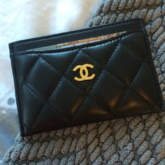 Chanel Card Case in (luscious) Black Lambskin Leather with Gold Hardware. First Chanel leather product, gifted by my baby sister. Convinced me that lambskin is the way to go.