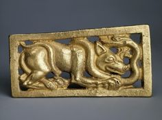 Belt Buckle with a Depiction of the Fight of Wolf and Snake (Rightward Direction) Author: Country: Collection:Archaeological Artifacts of Eastern Europe and Siberia Date:Sakae Culture. 7th - 5th century BC Technique:cast