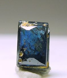 Trinity Mineral Co Auction: Minerals - Blue Anatase - Specimen Code Number: LU080204 - Uncommon Habit - Size: Thumbnail 0.4x0.3x0.2 cm - Location: Minas Gerais Brazil - This is a little crystal of gemmy, dark blue Anatase that has a strange crystal habit. Most Anatase from Brazil are octahedral. This one looks like it was faceted. it looks like a little gem. The faces are lustrous and it looks great when backlit. It weighs 0.37 carat and comes from an old production in Brazil. ???