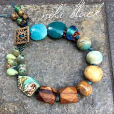 Made this bracelet using a HumbleBeads ceramic bead, ceramic beads by Gaea and others, wood beads, Czech glass beads and more. -Niki Black