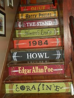 "My hand painted ""book spine"" steps.  Not perfect but proof anyone can do cool home decor projects. Find and size a font you like. Print it. Cut out the letters with an exacto knife. Tape it to the step. Stipple the acrylic paint over the stencil. Pull off the stencil.  Let dry completely. Seal with modge podge."
