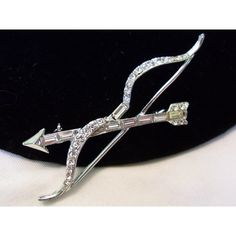 ART DECO Vintage Cupid Bow Arrow Glass Rhinestone Silver Plate Brooch... ($50) ❤ liked on Polyvore featuring jewelry, brooches, rhinestone brooches, vintage broach, rhinestone broach, druzy jewelry and art deco jewelry