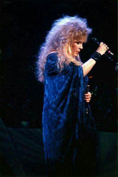 a serious screen capture of Stevie onstage, highlighting her mane of blonde hair that spills down her patterned dark blue shawl  ~ ☆☆♥♡☆♥☆☆