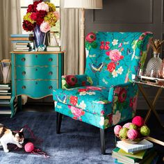 A graceful wing chair in search of a cozy corner, Asher is all about classic lines, capped midcentury modern legs and gorgeous color—and is ready to hold draped throws and stacked pillows. Why not invite a small table to hold tea and books?