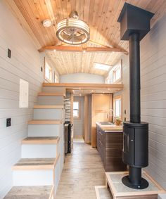 Inside the Blue Heron is a beautiful Morso wood stove with glass door, fir beamwork and cedar ceiling, and a custom storage staircase.